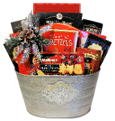 Let it Snow Gourmet Christmas Gift Basket with snacks in silver snowflake container.